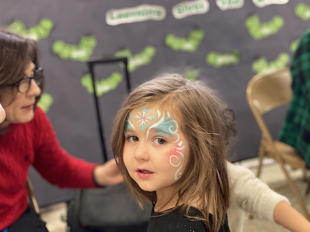 Social Gathering; girl with face painted