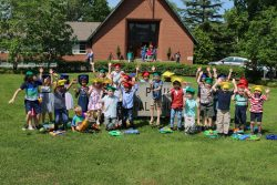 Pre-K graduates in front of St. Paul's sign