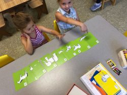 Children working with letter flash cards