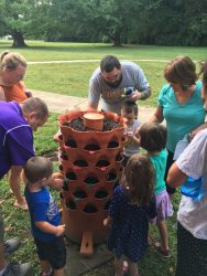 Families planting seeds in the garden tower