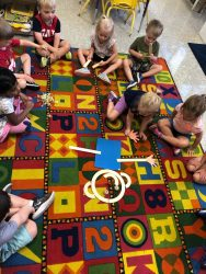 Children working as a group on the carpet