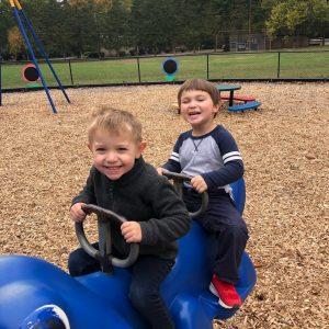 boys on riding toy on playground