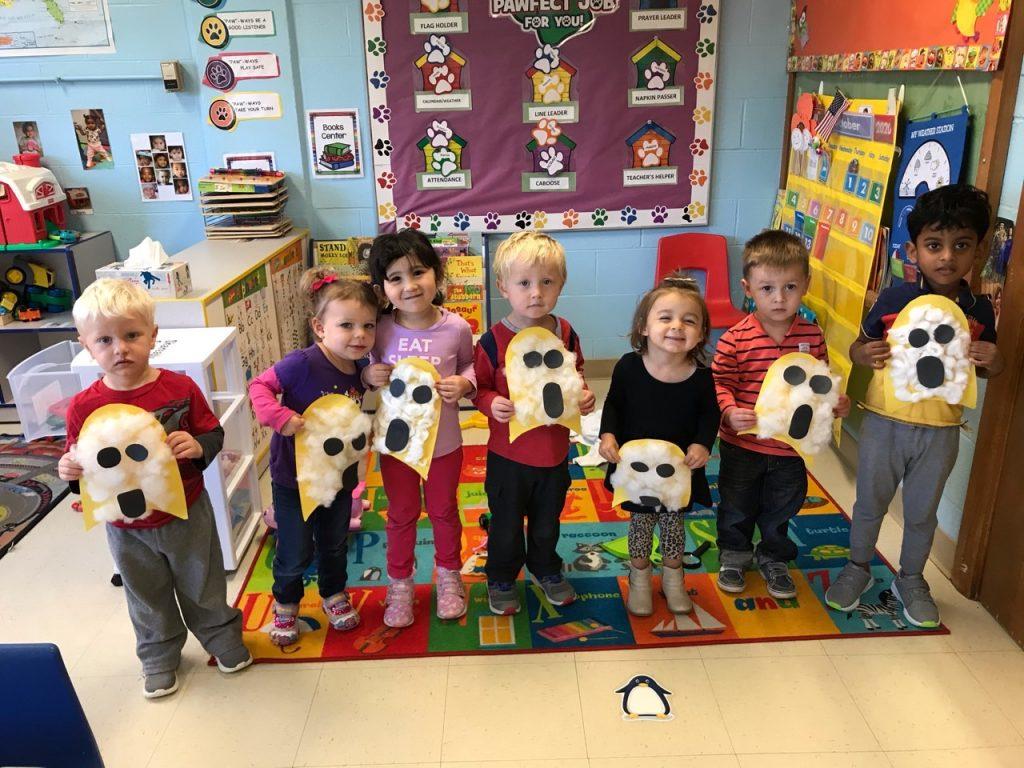 Children displaying their ghost artwork