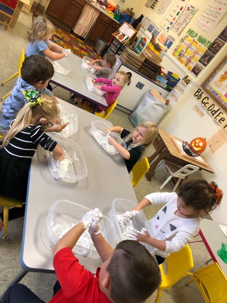 Kids exploring the properties of shaving cream